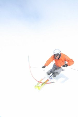 """Over exposed but I love it. I had to take the gate, lay it on the snow, and put the camera 3"""" from where it smacked dow to get this shot. I wore my helmet because the skiers kept hitting me with their poles."""