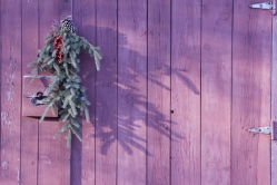 I like how the primitive wreath matches the primitive door.