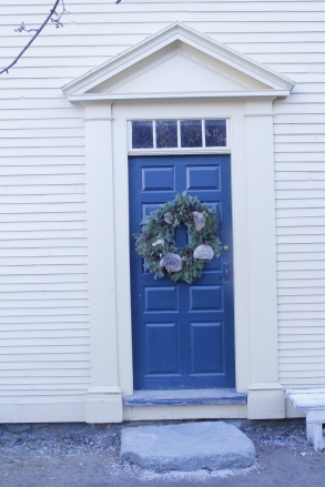 This wreath used dried shelf mushrooms to mimic seashells. Look at the ancient granite stoop.