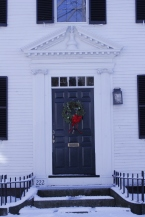 The oil lamp above the door signifies the house was owned by a whaling captain.
